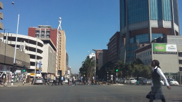 Pedestrians cross the road at one of the many intersections along Samora Machel Avenue