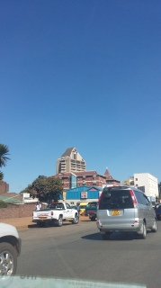 ZANU PF Headquarters stands out against a horizon of low buildings